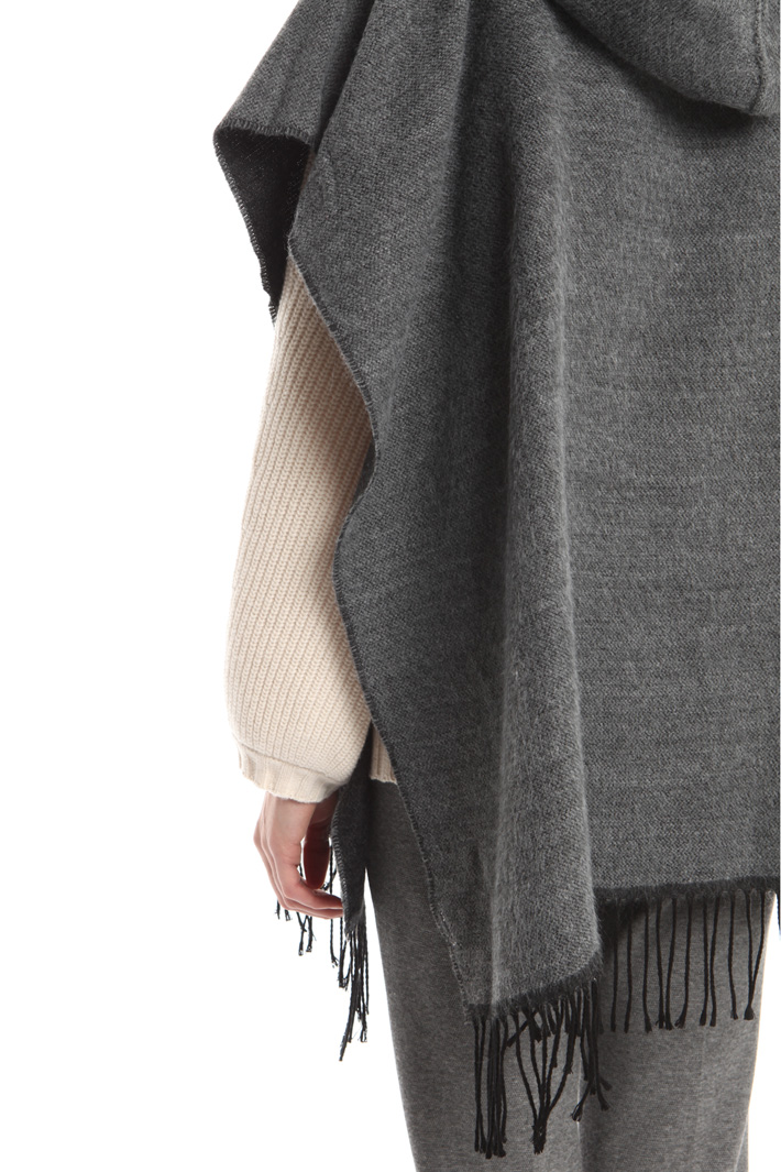 Fringed hooded poncho Intrend