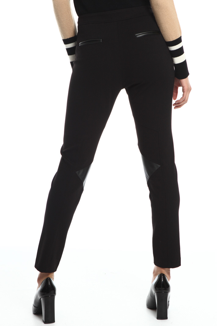 Trousers with coated inserts Intrend