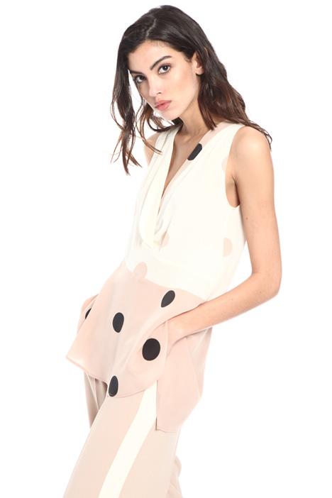 Asymmetrical sleeveless top Intrend