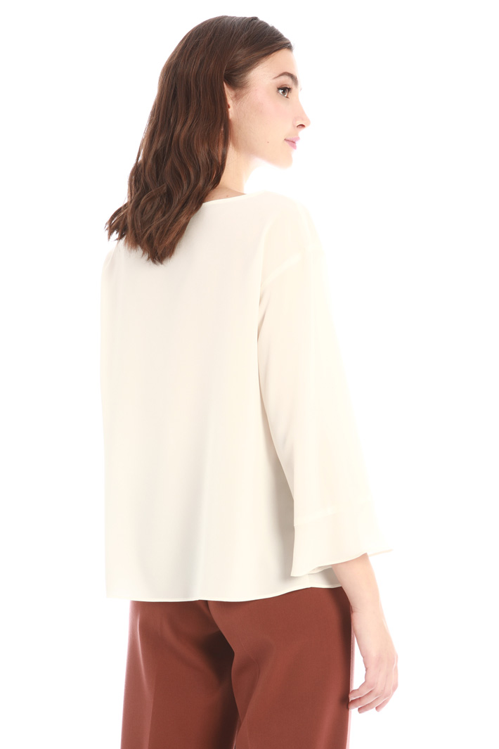 Blouse with frilled hem Intrend