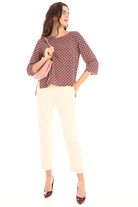 Asymmetrical patterned top Intrend